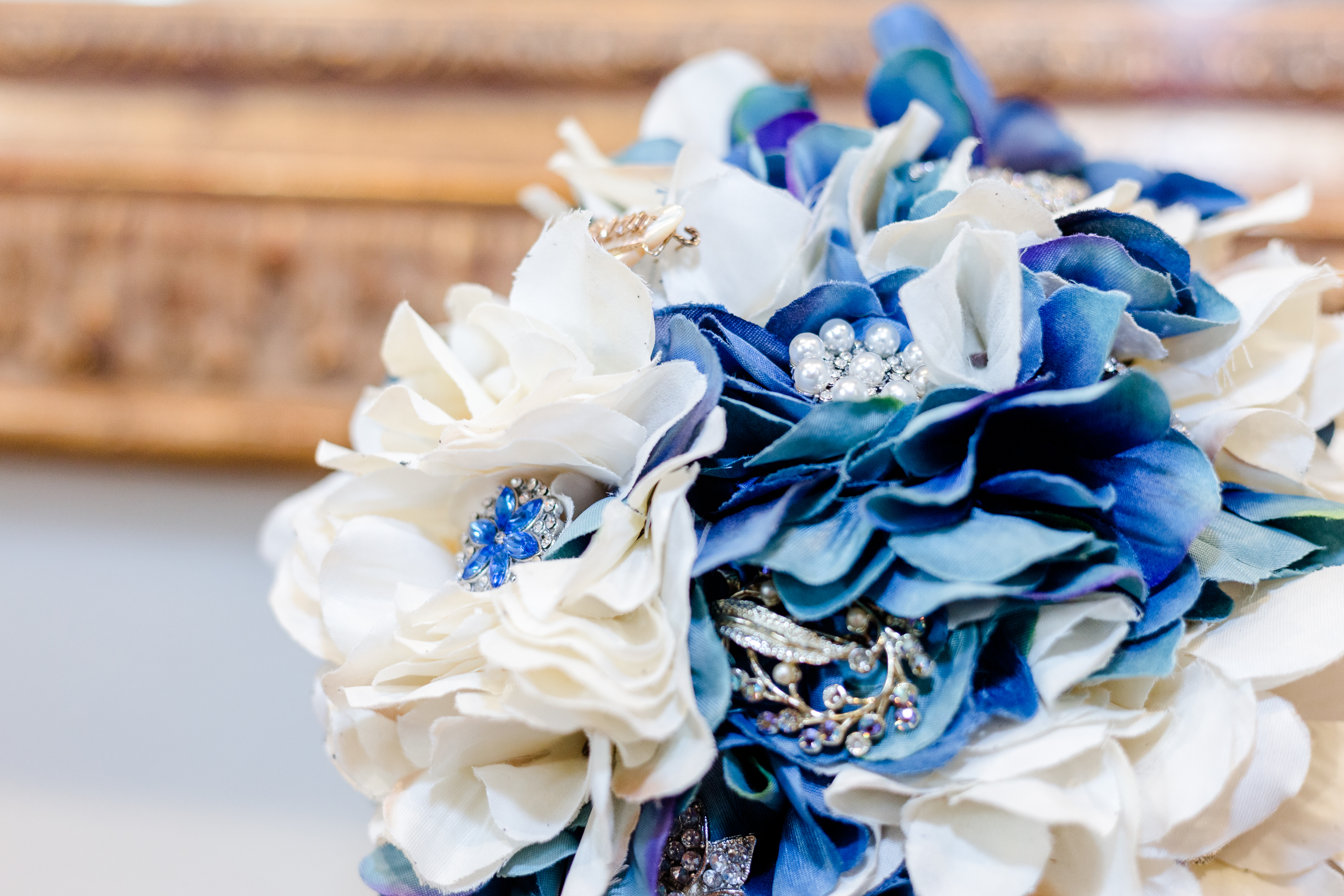 Closeup of a blue wedding bouquet with jewels and embellishments
