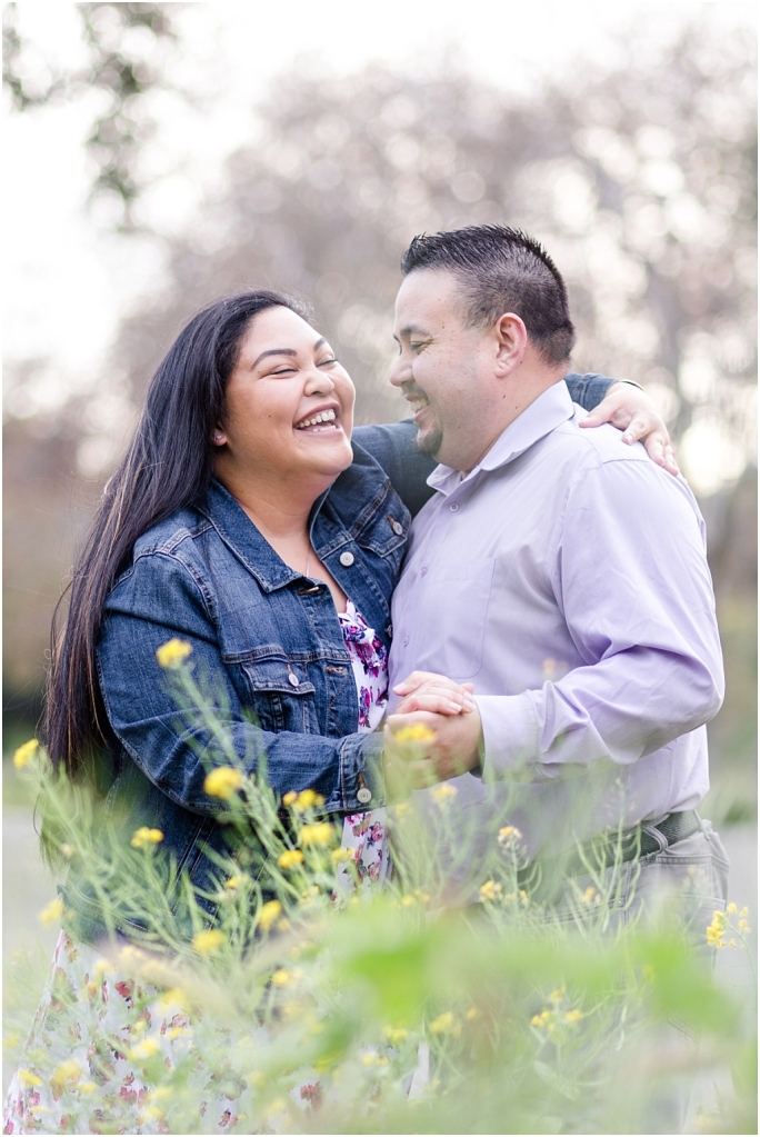 Couple laughing at Vallejo Mills Historical Park near Niles Canyon, standing in the wildflowers