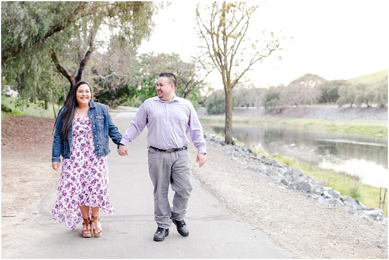 Couple on a trail at Niles Canyon near the staging area, holding hands and walking near the water