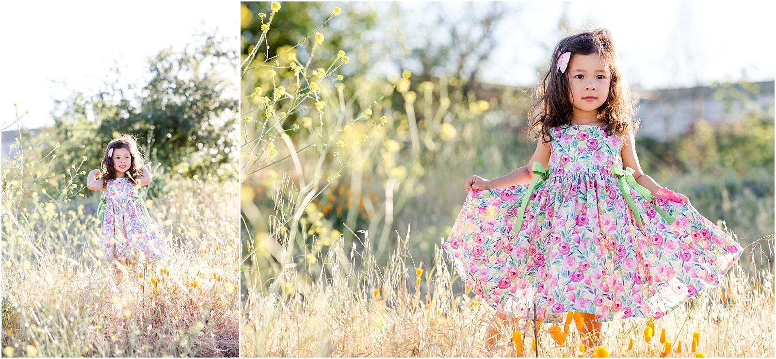 Girl in hand-sewn dress twirling in wildflower field